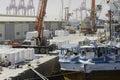 Large harbour crane loading cargo on a vessel at the Port of Salalah, 21 October, 2014, Salalah