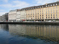 Large hotels form reflections in the Rhone River Royalty Free Stock Photography