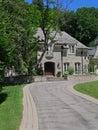 House with long circular driveway Royalty Free Stock Photo