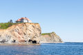 Large house on ocean cliff this is located just north of perce quebec canada the gulf of st lawrence Royalty Free Stock Photo