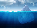 Large iceberg floating in water Stock Image