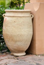 Large light brown golden color clay jar, flower pot. Royalty Free Stock Photo