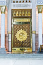 The large magestic doors of masjid nabawi gold doors islamic architecture islam frontal view photo Royalty Free Stock Photo