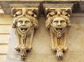 Large masks, architectural fantasy, the Chamber of Commerce, Cadiz, Andalusia, Spain Royalty Free Stock Photo