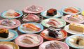Large meal of shushi sashimi with shrimp, salmon, tuna, squid an Royalty Free Stock Photo