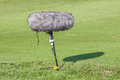 A large microphone boom with windshield situated in golf tournament for live broadcasting. Royalty Free Stock Photo