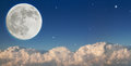 Large moon above dark clouds Royalty Free Stock Photo