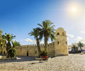 A large mosque in the town of sousse in tunisia against the back backdrop sun medina Stock Photo
