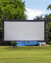 Large movie screen in the meadow of thai village Stock Photo
