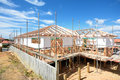 A large new home under construction wooden framed being built Stock Photo