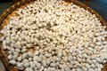 stock image of  Large number of silk cocoons from silk worms on bamboo tray