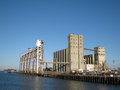 Large old rundown cement factory along the water Royalty Free Stock Photography