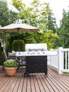 Large Outdoor Cooker on Cedar Deck Royalty Free Stock Photo