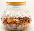 Large penny jar savings fund a glass filled with pennies representing saving for college retirement or something else in the Royalty Free Stock Photography