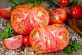 Large perfect cut tomato close-up Royalty Free Stock Photo