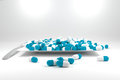 Large pile of blue colored pills on white plate Royalty Free Stock Photo