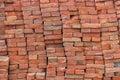 Large pile of red bricks background Royalty Free Stock Photo