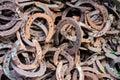 Large pile of rusty used Horseshoes