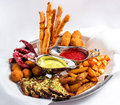 Large plate a wide selection snacks for beer served with of with two kinds of sauce on white background Royalty Free Stock Images