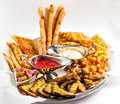 Large plate a wide selection snacks for beer served with of with two kinds of sauce on white background Stock Images
