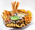 Large plate a wide selection snacks for beer served with of with two kinds of sauce on white background Royalty Free Stock Photography