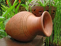 Large pot in garden Royalty Free Stock Image