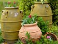 Large pots containing flowers tulips and hyacinths near a lake at shanghai flower port china on a sunny day Stock Image