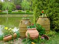 Large pots containing flowers tulips and hyacinths near a lake at shanghai flower port china on a sunny day Royalty Free Stock Photography