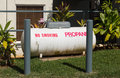 Large propane tank in landscaped garden Royalty Free Stock Photo