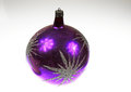 A large purple Christmas bauble on an isolated white background