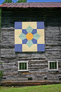 Large quilt square on barn a and two windows the side of a Royalty Free Stock Photo