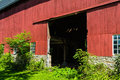 Large red barn old rustic with opening for doors Stock Photography