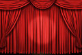 Large red curtain stage ans spot light Royalty Free Stock Photo