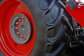 Large red wheel rim with rubber Stock Photography