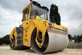 Large road roller paving a road construction Stock Photography