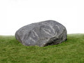 Large rock boulder on grass . Royalty Free Stock Photography