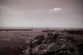 Large rock overlooking bridge over ocean Royalty Free Stock Photo