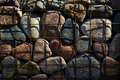 Large rocks contained in a wire cage multi colored river Royalty Free Stock Photography