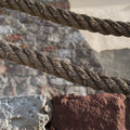 Large ropes stones and walls in a squared minimal composition Royalty Free Stock Photos