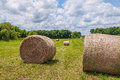 Large round hay bales balestwo grass in a farmers field Stock Photography