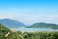Large sea bay with ships and green hills surrounded by Royalty Free Stock Images