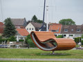 Large seating outsized sculpture in schleswig port north germany Royalty Free Stock Photography