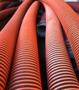 Large sewage pipes a pile of wide diameter made from corrugated plastic Stock Photography