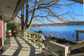 Large spacious deck of grey waterfront home Royalty Free Stock Photo