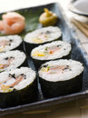 Large Spiral Rolled Sushi with Sushi Ginger Wasabi Stock Image