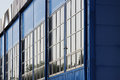 large sports complex. big blue building with many windows. Royalty Free Stock Photo