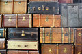 Large stack of antique suitcases background with Stock Photo