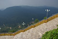 Large stairways in the middle of hilly mountainous jungle Royalty Free Stock Photo