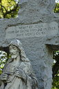 Large stone jesus christ statue with engraved cross quote on Stock Image