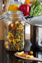 Large Storage Jar with Colorful Pasta and Cooking Spoon Royalty Free Stock Photography
